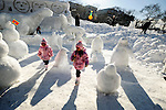 Young children look at ice  sculptures depicting penguins during the Sapporo Snow and Ice Festival in Sapporo City, northern Japan. Around 2 million people visit the city to see the hundreds of hand-crafted snow and ice sculptures that have graced the Sapporo Snow and Ice Festival since its inception in 1950.