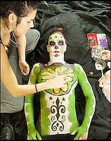 BNPS.co.uk (01202 558833)<br /> Pic: ReneRodriguez/BNPS<br /> <br /> ***Must use full byline***<br /> <br /> Body paint being applied. <br /> <br /> This may look like an ornate Mexican sugar skull but a closer inspection reveals it is actually made up of cleverly painted people.<br /> <br /> The incredible artwork is comprised of seven nude women who have each been covered in sparkling white body paint and brightly coloured patterns.<br /> <br /> When the models all get into position they form a perfect sugar skull - the brightly coloured icon of the Day of the Dead festival, a Mexican tradition.<br /> <br /> The idea for the eye-catching piece was thought up by Rene Rodriguez, a photographer in Los Angeles, USA.