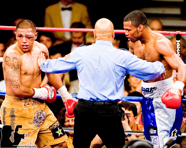 FEBRUARY 24 2006 The left eye of Fernando Vargas (L) swells  and is stopped in the 10th by referee Joe Cortez.  Mosley was given the 10th round TKO victory of the junior middleweight fight at the Mandalay Bay Events Center on February 25, 2006 in Las Vegas, Nevada.