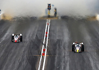 Feb 22, 2014; Chandler, AZ, USA; A pair of NHRA jet dragster drivers launch off the starting line as smoke fills the air during qualifying for the Carquest Auto Parts Nationals at Wild Horse Motorsports Park. Mandatory Credit: Mark J. Rebilas-USA TODAY Sportss