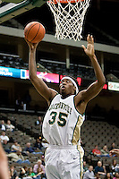 January 14, 2010:    Jacksonville forward/center Will Alston (35) goes up for a basket during Atlantic Sun conference game action between the Jacksonville Dolphins and the Lipscomb Bisons at Veterans Memorial Arena in Jacksonville, Florida.  Jacksonville defeated Lipscomb 79-73.