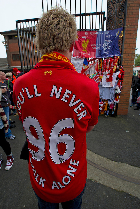 Fans gather at the memorial to those who died at the 1989 Hillsborough disaster outside Anfield, home of Liverpool FC..Football - Barclays Premiership - Liverpool v Manchester United - Sunday 23rd September 2012 - Anfield - Liverpool..
