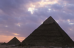 The Pyramids of Giza consist of the Great Pyramid of Giza also known as The Pyramid of Khufu, the somewhat smaller Pyramid of Khafre and the relatively modest sized Pyramid of Menkaure. Egyptologists believe that the Great Pyramid was built as a tomb for the Pharaoh Khufu around 2560 BC.It is the oldest of the seven wonders of the ancient world. At 481 feet high it remained the tallest man made structure in the world for over 3,800 years.