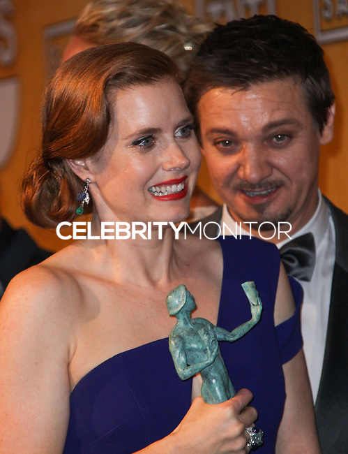 LOS ANGELES, CA - JANUARY 18: Amy Adams, Jeremy Renner in the press room at the 20th Annual Screen Actors Guild Awards held at The Shrine Auditorium on January 18, 2014 in Los Angeles, California. (Photo by Xavier Collin/Celebrity Monitor)