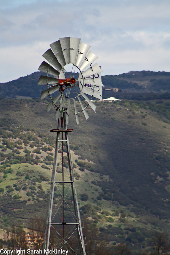 A windmill stands above a vineyard near the hills around Oakville in Napa County in Northern California.