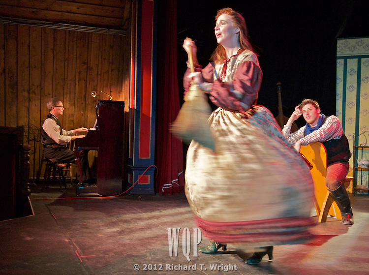 Amy Newman performs at the Theatre Royal Barkerville, with Jim Hodgkinson on piano and Grfame Thompson watching.