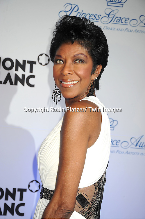 Natalie Cole in white Givanni dress attends The Princess Grace Foundation Awards Gala on ..November 1, 2011 at Cipriani 42nd Street in New York City.