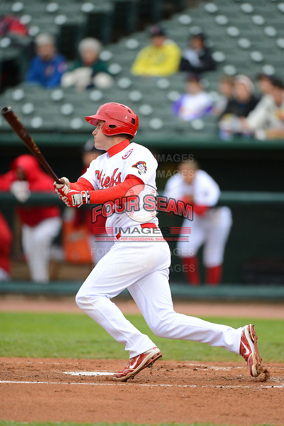 Peoria Chiefs first baseman Patrick Wisdom #29 hits a double during a game against the Wisconsin Timber Rattlers on May 25, 2013 at Dozer Park in Peoria, Illinois.  Peoria defeated Wisconsin 6-0.  (Mike Janes/Four Seam Images)