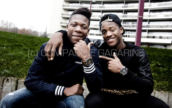 Belgian football players and brothers Aaron Leya Iseka Batshuayi and Michy Batshuayi with their parents at their home in Brussels (Belgium, 17/12/2013)