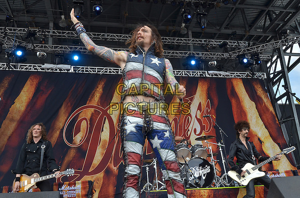 "Lead vocalist JUSTIN HAWKINS of the British glam rock band THE DARKNESS performs at Day 2 of the  'Rock On The Range Festival"" held at Crew Stadium, Columbus, OH., USA..May 20th, 2012             .on stage in concert live gig performance performing music full length red white blue stars striped trousers sleeveless top arm in air moustache mustache facial hair tattoos.CAP/ADM/JN.©Jason L Nelson/AdMedia/Capital Pictures."