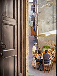 Afternoon dining outside the door of the Church of the Madonna dei Lumi, San Gimignano, Siena-Tuscano, Italy