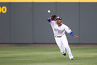 Round Rock Express outfielder Engel Beltre #7 makes a running catch in center field against the Omaha Storm Chasers in the Pacific Coast League baseball game on April 4, 2013 at the Dell Diamond in Round Rock, Texas. Round Rock defeated Omaha in their season opener 3-1. (Andrew Woolley/Four Seam Images).