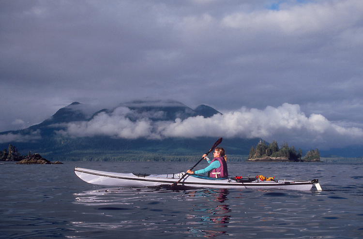 Sea Kayaking, Vancouver Island, Woman kayaking Clayoquot Sound, West coast Vancouver Island, British Columbia, Canada, Maggie Coon, model released,.