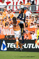Los Angeles Galaxy forward Edson Buddle (14) and Houston Dynamo defender Bobby Boswell (32) go up for the header. Houston Dynamo tied Los Angeles Galaxy 0-0 at Robertson Stadium in Houston, TX on October 18, 2009.