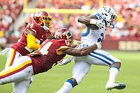 Landover, MD - September 16, 2018: Indianapolis Colts running back Marlon Mack (25) is tackled by Washington Redskins linebacker Mason Foster (54) during the  game between Indianapolis Colts and Washington Redskins at FedEx Field in Landover, MD.   (Photo by Elliott Brown/Media Images International)