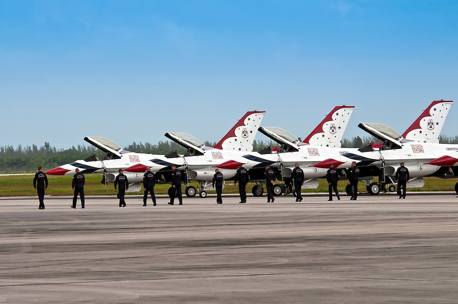 HOMESTEAD, FL - NOVEMBER 8, 2009: Thunderbirds Pilots walking in front of their F-16 jets on tarmac at Wings over Homestead Airshow. 8, 2009: Thunderbirds Pilots walking in front of their F-16 jets on tarmac at Wings over Homestead Airshow., FL - November 8, 2009:  SNJ-5 demonstration at Wings over Homestead Airshow, The SNJ-5 was the Navy's advanced trainer aircraft from 1936 through the 1940s and a primary trainer in the 1950s.  SNJ-5 demonstration at Wings over Homestead Airshow, The SNJ-5 was the Navy's advanced trainer aircraft from 1936 through the 1940s and a primary trainer in the 1950s. 8, 2009: Thunderbirds Pilots walking in front of their F-16 jets on tarmac at Wings over Homestead Airshow.