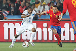 21 JUN 2010: Wilson Palacios (HON) (left) and Xavi (ESP) (right). The Spain National Team defeated the Honduras National Team 2-0 at Ellis Park Stadium in Johannesburg, South Africa in a 2010 FIFA World Cup Group H match.