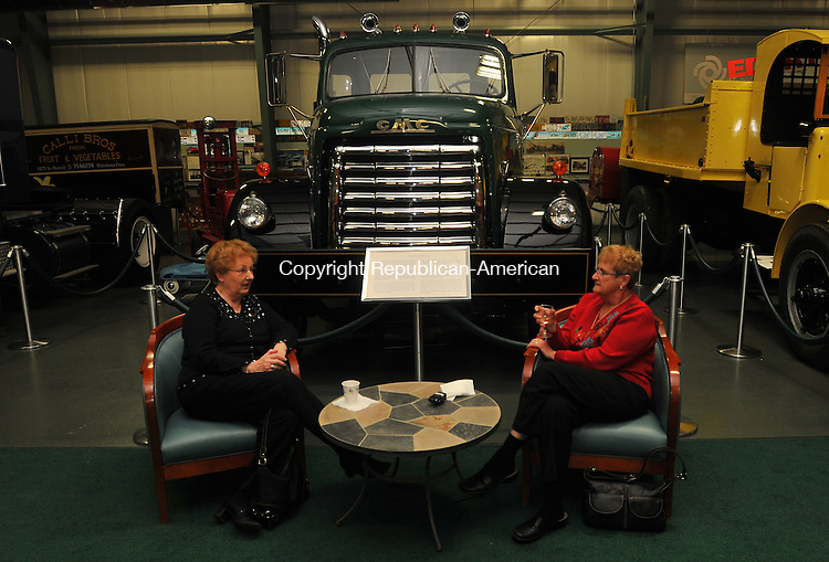 MIDDLEBURY, CT- 06 February 2010 - 020610IP07- Lori Zionkowski (left) of Middlebury and Denise Welch of Southbury chat next to a 1952 GMC Model 950 truck during The Golden Age of Trucking Museum's annual &quot;February Fundraiser&quot; benefit in Middlebury on Saturday. The money raised will allow the museum to expand its desplays, update the children's area and maintain current exhibits.<br /> Irena Pastorello Republican-American