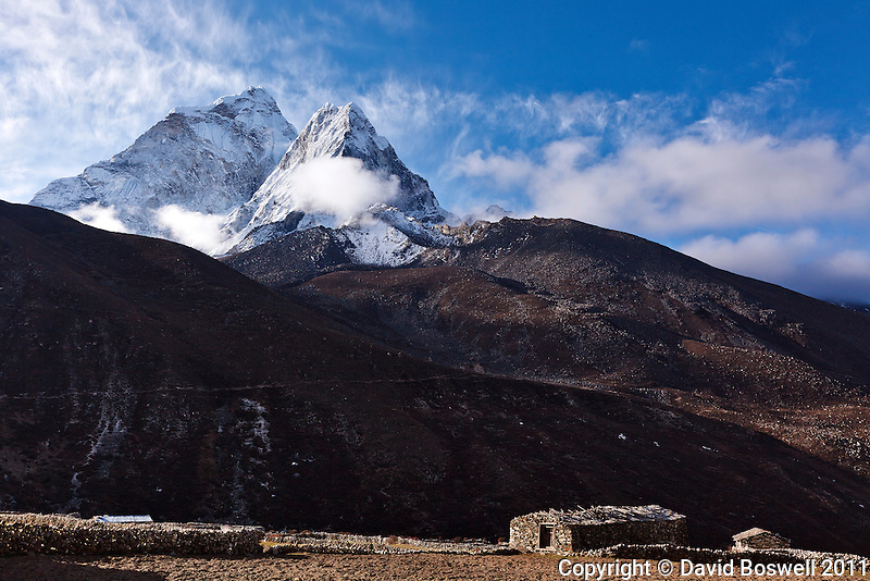 Ama Dablan (22,493 ft./6856 m.) stands watch over a stone farmhouse in the village of Dingboche.  Dongboche is located in the Khumbu Valley, Nepal, along the trail to Everest Base Camp.