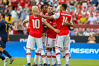 Landover, MD - July 23, 2019: Arsenal players celebrate after a goal during the match between Arsenal and Real Madrid at FedEx Field in Landover, MD.   (Photo by Elliott Brown/Media Images International)