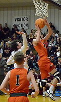 Westside Eagle Observer/MIKE ECKELS<br /> <br /> Lion Brayden Trembly (33 right) puts up a jumper during the first quarter of the  Gravette-Gentry conference match up at the competition gym Jan. 7.