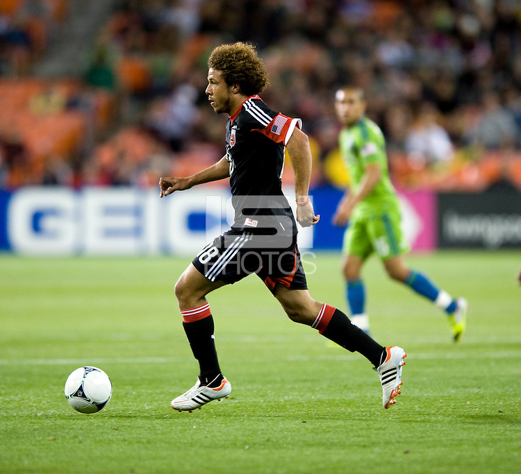 Nick DeLeon (18) of D.C. United brings the ball up the field during the game at RFK Stadium in Washington DC.   D.C. United tied  the Seattle Sounders, 0-0.