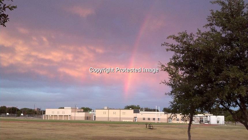 Rainbow at sunset over school