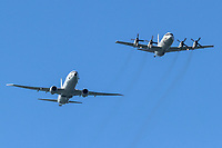 A Lockheed P-3 Orion flies in formation with its succesor the Boeing P-8 Poseidon.