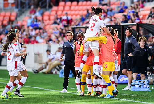 19.02.2016. Houston, TX, USA. Canada Forward Christine Sinclair (12) is congratulated by Team Canada after scoring a first half goal during the Women's Olympic qualifying soccer match between Canada and Costa Rica at BBVA Compass Stadium in Houston, Texas.
