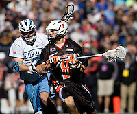 Nate Matthews (2) of Johns Hopkins closes in on Mike Grossman (8) of Princeton during the Face-Off Classic in at M&T Stadium in Baltimore, MD