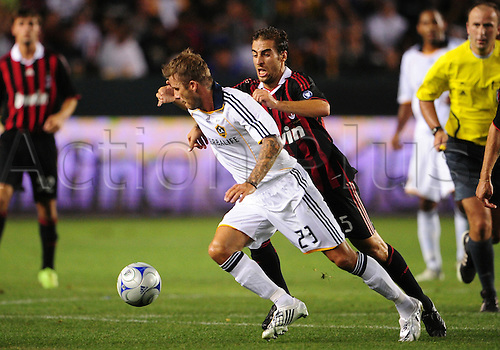 19 July 2009: Galaxy #23 David Beckham maneuvers around AC Milan #5 Mathieu Flamini  during an international friendly match between AC Milan and the Los Angeles Galaxy at the Home Depot Center in Carson, CA.(Photo: Chris Williams/Actionplus) UK Licenses Only