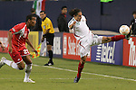 21 June 2007:  Mexico's Jose Andres Guardado (18) stretches to control a ball in front of Guadeloupe's David Fleurival (21). The National Team of Mexico defeated Guadeloupe 1-0  in a CONCACAF Gold Cup Semifinal match at Soldier Field in Chicago, Illinois.