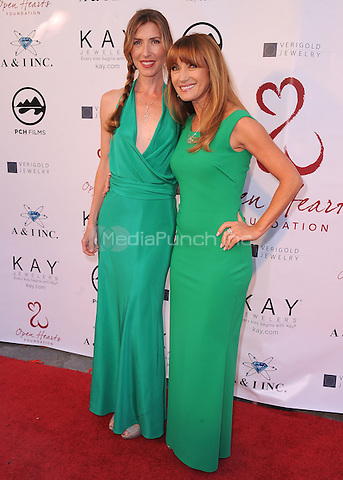 MALIBU, CA - MAY 10:  Katherine Flynn and Jane Seymour at the 4th Annual Open Hearts Gala at a private residence on May 10, 2014 in Malibu, California. Credit: PGSK/MediaPunch