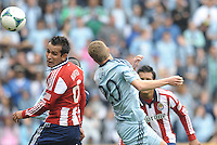 Jose Manuel Rivera (6) forward Chivas USA wins the header against Oriol Rosell (20) midfield Sporting KC ..Sporting Kansas City defeated Chivas USA 4-0 at Sporting Park, Kansas City, Kansas.