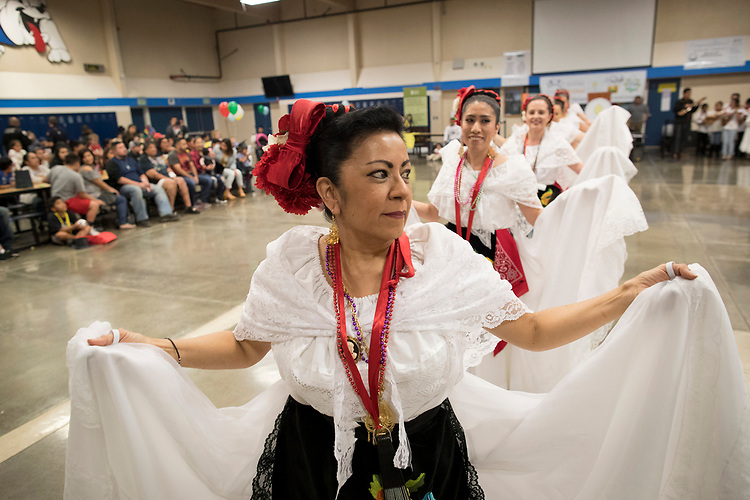 Rosa Floyd, a dance instructor for the dance group, Coscha Mestiza, leads her group in dance during the Dia de Nino event at Woodburn High School.<br /> Photo by Jaime Valdez