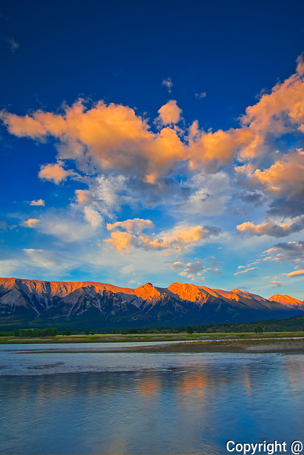 Clouds reflected in Abraham Lake at sunrise. The Canadian Rocky Mountains.<br />