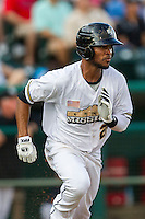 San Antonio Missions shortstop Jeudy Valdez (24) runs to first base in the Texas League baseball game against the Frisco Roughriders on August 22, 2013 at the Nelson Wolff Stadium in San Antonio, Texas. Frisco defeated San Antonio 2-1. (Andrew Woolley/Four Seam Images)