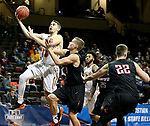 SIOUX FALLS, SD - MARCH 20: Peter Firlik #32 from Farris St. takes the ball to the basket past Sawyer Glick #11 from Barry during their quarterfinal game at the 2018 Elite Eight Men's NCAA DII Basketball Championship at the Sanford Pentagon in Sioux Falls, SD. (Photo by Dave Eggen/Inertia)