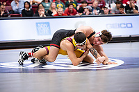 STANFORD, CA - March 7, 2020: Jackson DiSario of Stanford and Brandon Courtney of Arizona State University during the 2020 Pac-12 Wrestling Championships at Maples Pavilion.