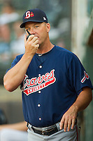 Gwinnett Braves pitching coach Marty Reed #22 uses a walkie-talkie to communicate with the bullpen during the International League game against the Charlotte Knights at Knights Stadium on June 3, 2012 in Fort Mill, South Carolina.  The Braves defeated the Knights 5-1.  (Brian Westerholt/Four Seam Images)