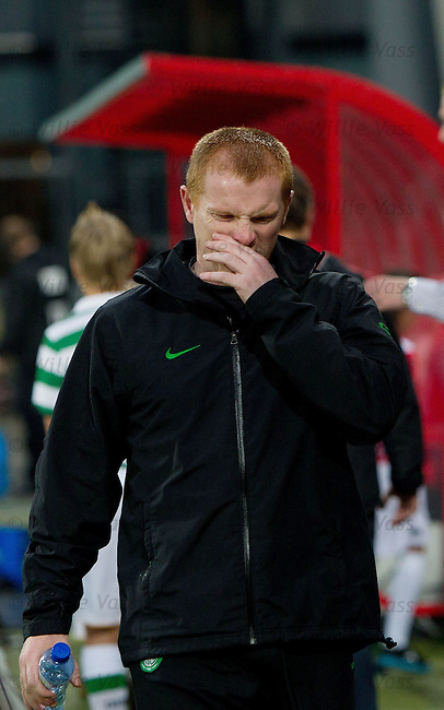 Neil Lennon walks off at the end of the match