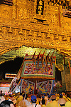 Donggang, Taiwan -- The King Boat is wheeled through the main gate at Donglong Temple for its short journey through the midnight streets of Donggang.