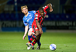 St Johnstone v St Mirren...20.09.11   Scottish Communities League Cup Third Round.Nigel Hasslebaink is tackled by Liam Craig.Picture by Graeme Hart..Copyright Perthshire Picture Agency.Tel: 01738 623350  Mobile: 07990 594431