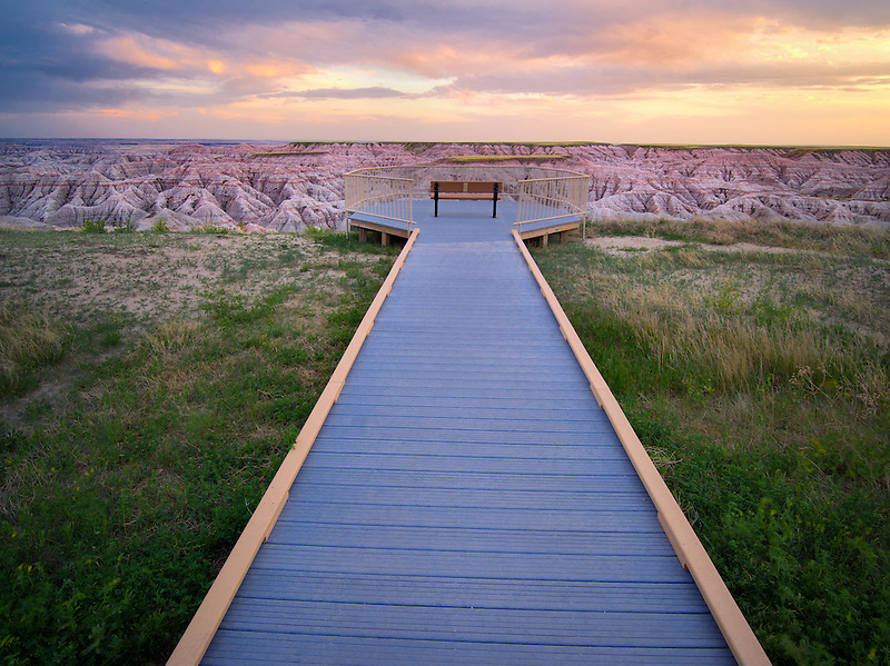 Pathway and sunset in Badlands National Park, South Dakota.