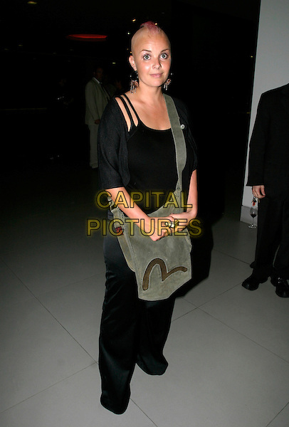 GAIL PORTER.Living TV autumn/winter 2005/06 schedule - launch party at the Cumberland Hotel, London..September 8th, 2005.full length pink hair shaved head mohawk black trousers top green bag.www.capitalpictures.com.sales@capitalpictures.com.© Capital Pictures.