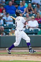Keenyn Walker (4) of the Winston-Salem Dash follows through on his swing against the Carolina Mudcats at BB&T Ballpark on June 6, 2014 in Winston-Salem, North Carolina.  The Mudcats defeated the Dash 3-1.  (Brian Westerholt/Four Seam Images)
