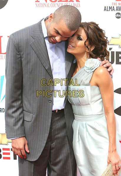 TONY PARKER & EVA LONGORIA.2007 NCLR ALMA Awards - Arrivals held at the Pasadena Civic Center, Pasadena, California, USA,.01 June 2007..half length grey suit jacket pale blue dress couple fiance engaged.CAP/ADM/CH.©Charles Harris/AdMedia/Capital Pictures. *** Local Caption *** .