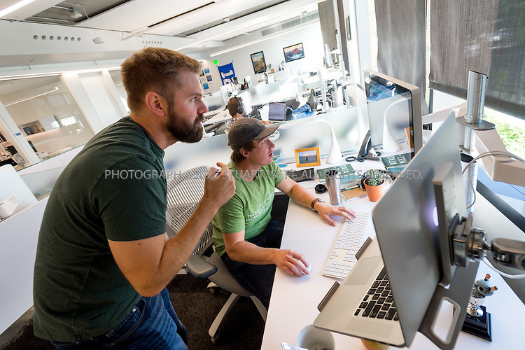 SEATTLE, USA - SEPTEMBER 16th, 2015<br /> <br /> Mark Schaake, a Principal Software Engineer (left), and Sam Skjonsberg, a Lead Front End Engineer (right) discuss a problem at the Allen Institute for Artificial Intelligence in Seattle, WA, USA.<br /> <br /> The Allen Institute for Artificial Intelligence (abbreviated AI2) is a research institute funded by Microsoft co-founder Paul Allen to achieve scientific breakthroughs by constructing AI systems with reasoning, learning and reading capabilities. Oren Etzioni was appointed by Paul Allen in September 2013 to direct the research at the institute.<br /> <br /> (Photo by Stuart Isett for The Washington Post)