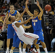 Ohio State's Evan Turner gets off a pass under pressure from UC Santa Barbara's Paul Roemer during the NCAA playoff game in Milwaukee on Friday, March 19, 2010. UC Santa Barbara photo by Ernie Mastroianni.