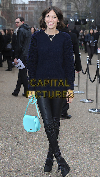 ALEXA CHUNG.The Burberry Prorsum Fashion Show during London Fashion Week Autumn/Winter 2011, Kensington Gardens, London, England..21st February 2011.LFW full length top black blue jeans denim shoes blue turquoise bag purse .CAP/BEL.©Tom Belcher/Capital Pictures.